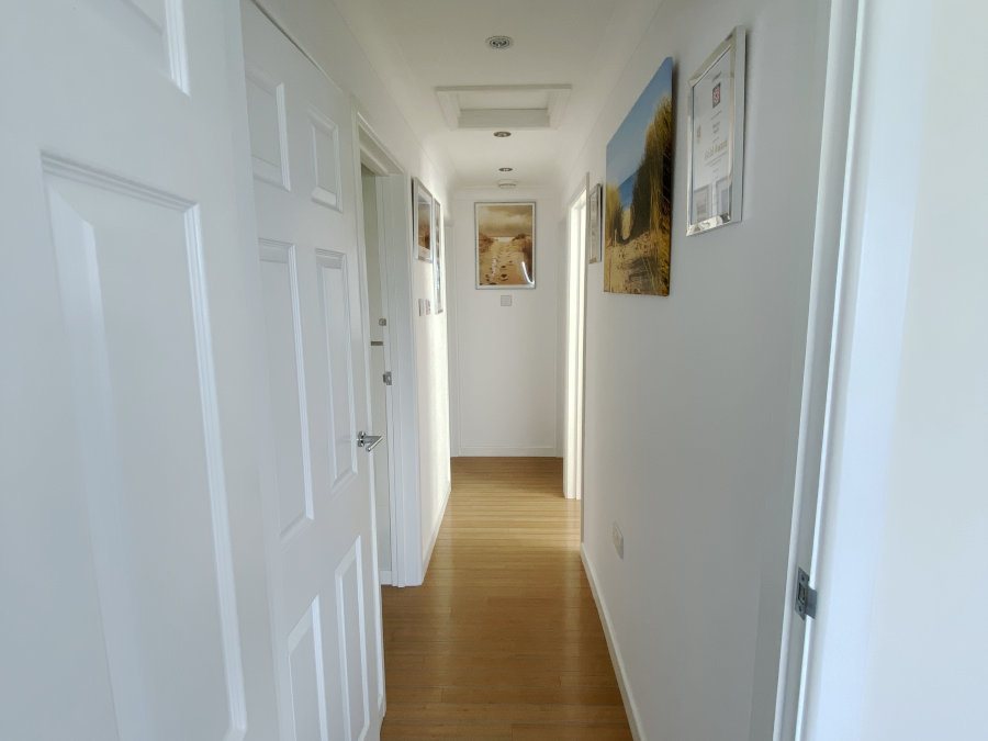 Hallway showing Hayle Towans through the years